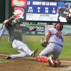 Manuel Margot slides into home safely as Reading catcher Andrew Knapp waits for the throw in the second inning of the Sea Dogs' 5-4 win in the first game of a doubleheader Monday in Portland. Reading won the second game 6-1.
