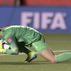 U.S. keeper Hope Solo covers the ball after making a save against China during the second half of a quarterfinal match in the FIFA Women's World Cup soccer tournament, Friday in Ottawa, Ontario, Canada.  The Associated Press
