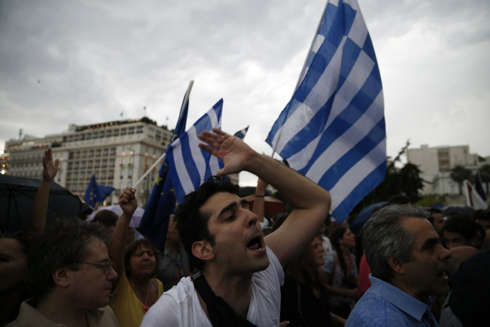 "A demonstrator shouts slogans during a rally in Athens on Tuesday that was organized by supporters of the ""yes"" vote for an upcoming referendum on whether Greek residents want to accept creditors' terms for a bailout."