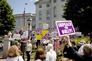 A rally organized by two acquaintances – one Republican and one Democrat – brought about 150 people to the State House in Augusta on Tuesday to support an investigation and potential impeachment proceedings against Gov. Paul LePage over some of his recent actions and statements.