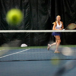 Olivia Leavitt of Falmouth returns a shot during the state tennis singles championship match.