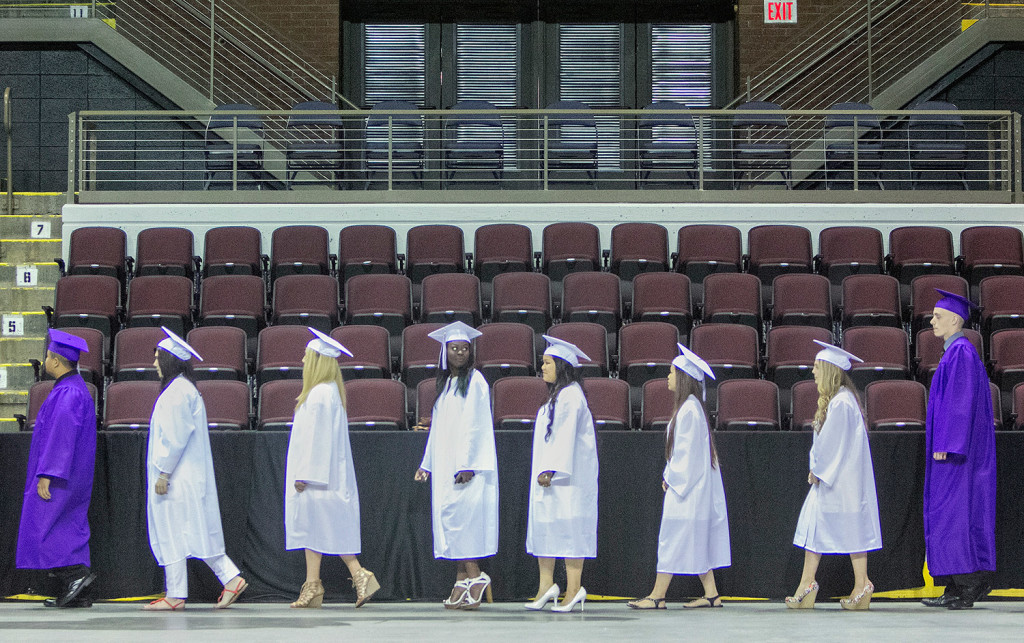 Deering High School seniors start the processional to their seats inside the Cross Insurance Arena during Deering's graduation in Portland on Wednesday.