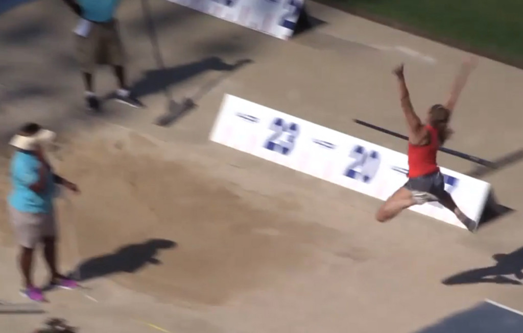 In this image taken from video, Kate Hall makes her record-setting long jump Sunday at the New Balance Nationals in Greensboro, N.C.