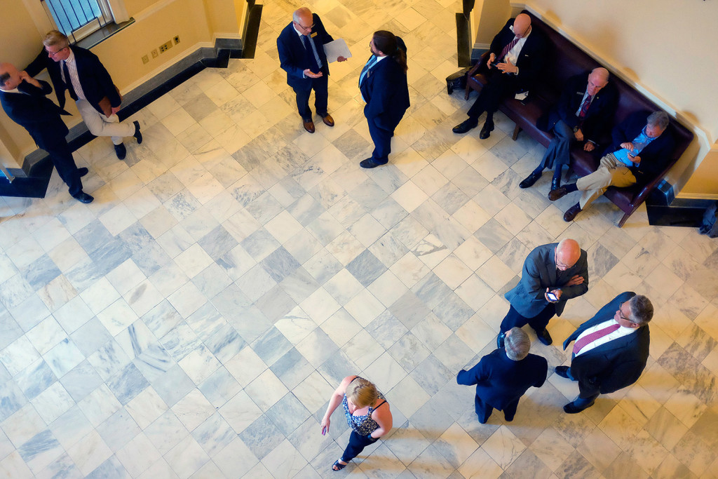 Lawmakers and lobbyists wait outside the Senate and House chambers during a recess as the Legislature gets set to tackle veto overrides for much of the afternoon Tuesday.