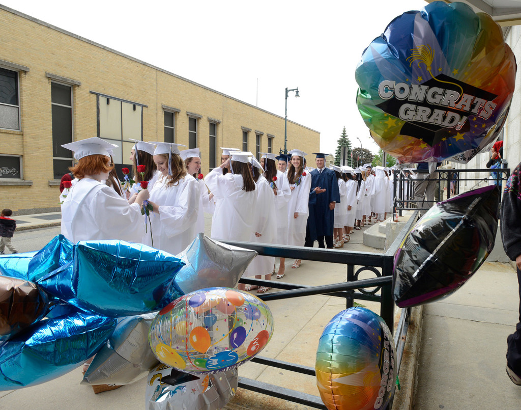 Balloons flutter in a breeze as seniors line up outside City Hall as Portland High School holds its 194th graduation exercises at Merrill Auditorium in Portland on Thursday.