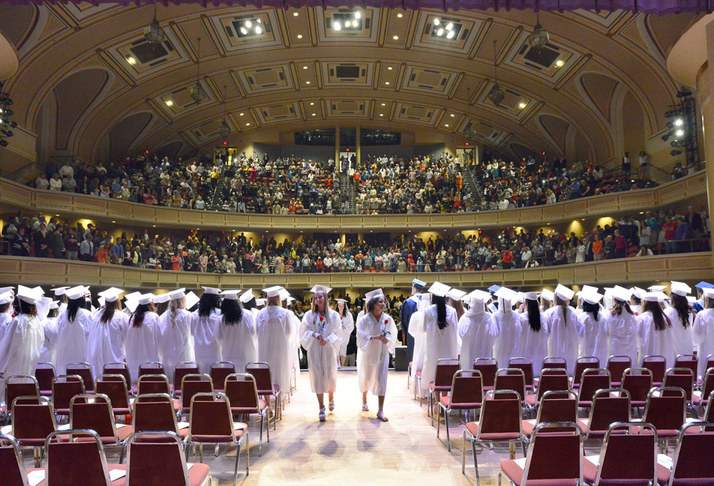 Seniors assemble on stage before a packed house as Portland High School holds its 194th graduation exercises at Merrill Auditorium in Portland on Thursday.