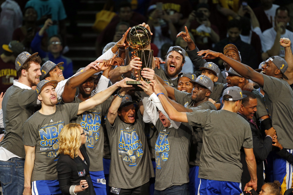 The Golden State Warriors celebrate after winning the NBA title against the Cleveland Cavaliers on Tuesday night. The Warriors defeated the Cavaliers, 105-97, to win the best-of-seven game series 4-2. The Associated Press