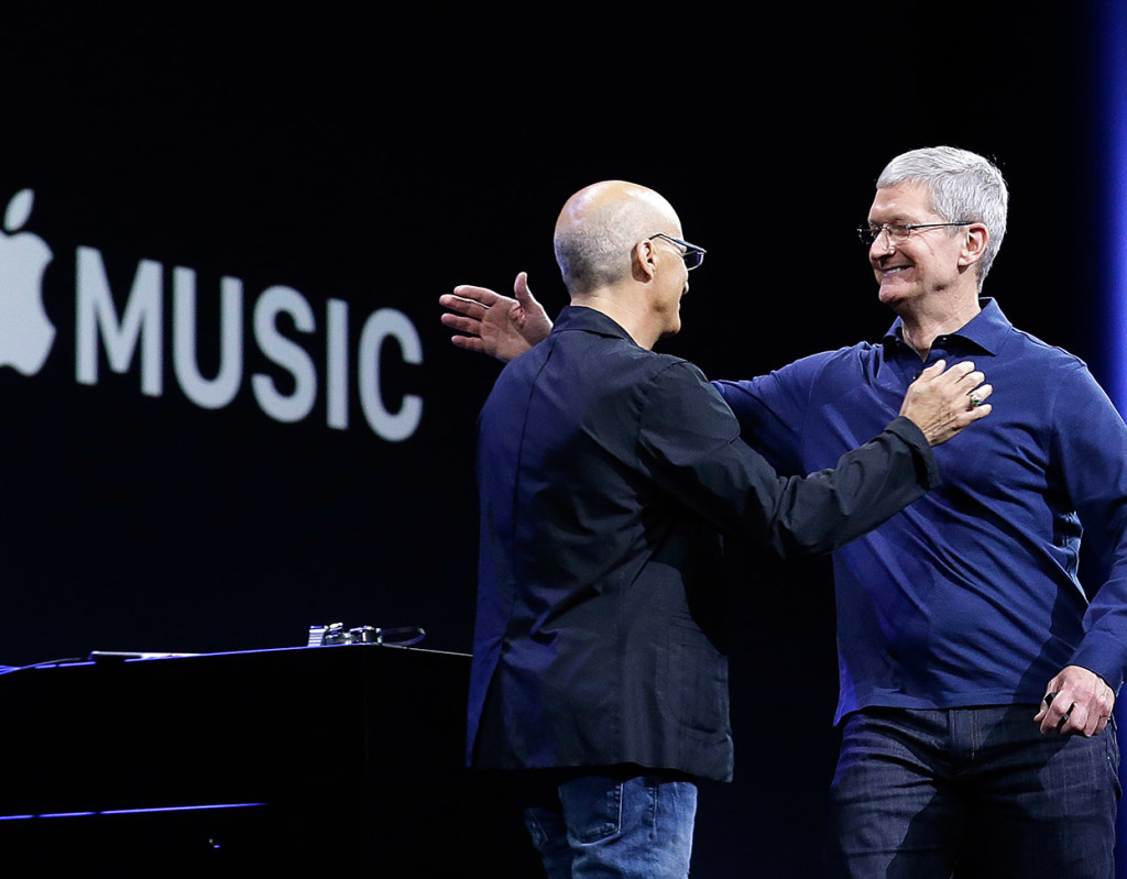Apple CEO Tim Cook, right, hugs Beats by Dre co-founder and Apple employee Jimmy Iovine at the Apple Worldwide Developers Conference in San Francisco on Monday. Apple Music, a new, paid music streaming service will launch this month.