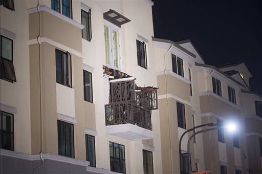 A fourth-floor balcony rests on the balcony below after collapsing at the Library Gardens apartment complex in Berkeley, Calif., early Tuesday. The Associated Press