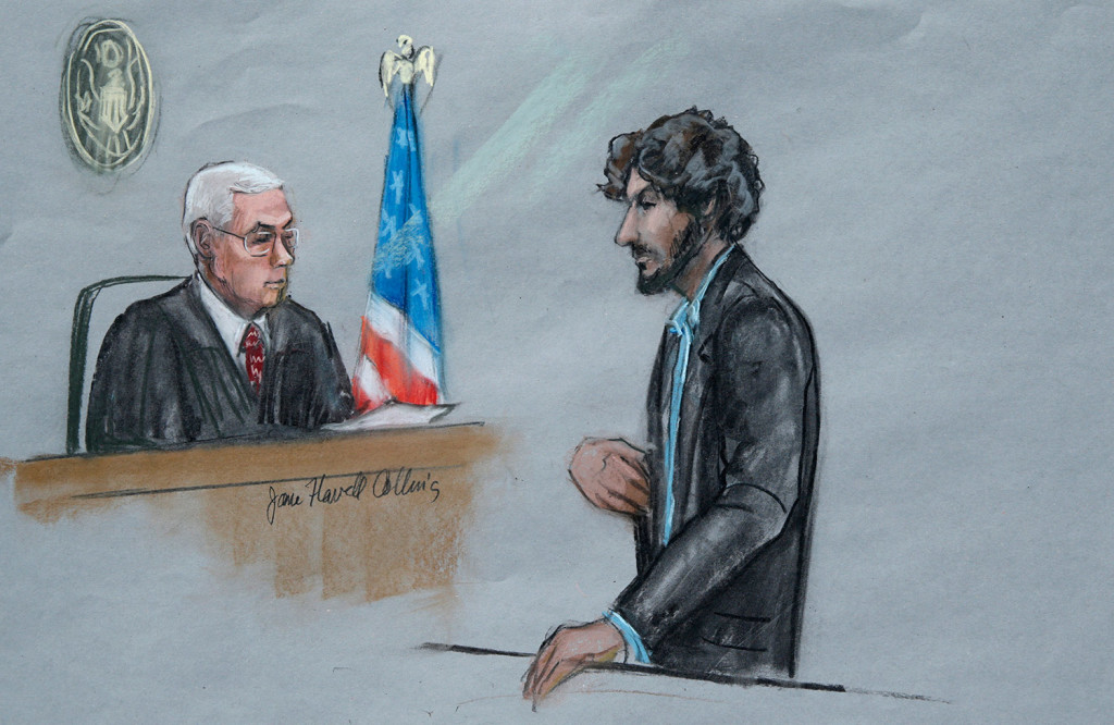 In this courtroom sketch, Boston Marathon bomber Dzhokhar Tsarnaev, right, stands before U.S. District Judge George O'Toole Jr. as he addresses the court during his sentencing Wednesday in federal court in Boston.