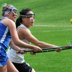 PORTLAND, ME - APRIL 30: Kennebunk's #14 Carly Sandler and Waynflete's # 1 Helen Gray-Bauer chase the ball as Waynflete hosts Kennebunk HS  girls lacrosse. (Photo by John Patriquin/Staff Photographer)