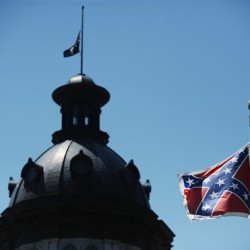 The Confederate flag still flies near the South Carolina Statehouse, in Columbia.  The Associated Press