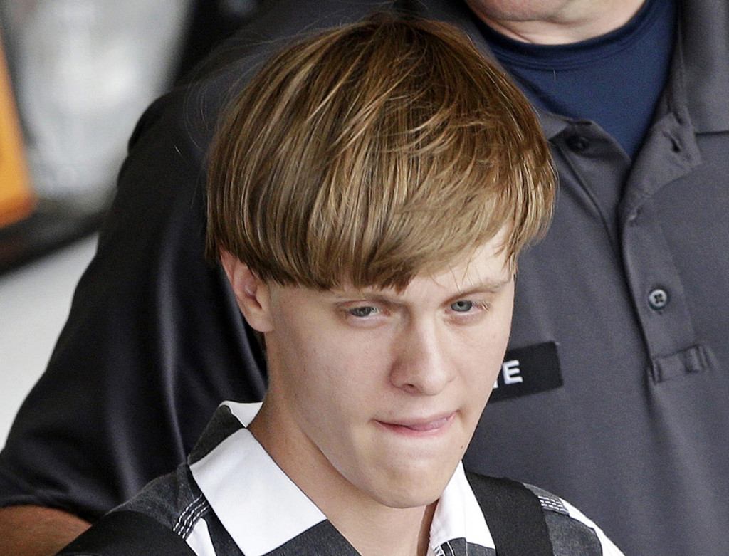 Charleston, S.C., shooting suspect Dylann Storm Roof is escorted from the Cleveland County Courthouse in Shelby, N.C., Thursday. The Associated Press