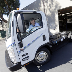 Wrightspeed CEO Ian Wright drives an electric-powered truck at the company's headquarters in San Jose, California. Wrightspeed,makes electric powertrains that can be installed on commercial trucks, making them more energy-efficient. The Associated Press