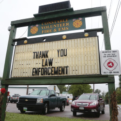 A sign at the Constable Volunteer Fire and EMS thanks law enforcement after the second of two escaped prisoners was apprehended on Sunday, in Constable, N.Y. The Associated Press