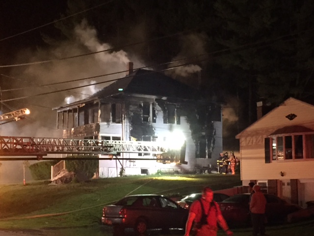 Firefighters and police said the building at 94 Pierce St. in Westbrook appeared to be a total loss after the fire Friday night. Edward D. Murphy photo