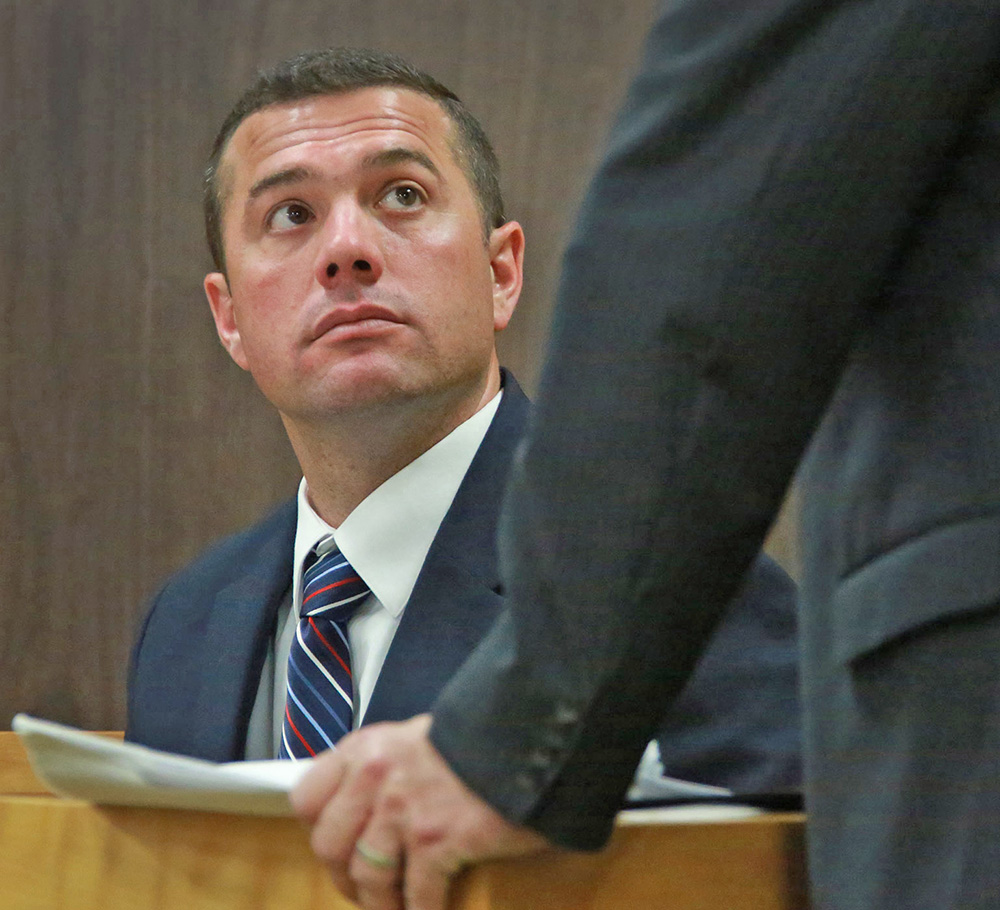 Sgt. Aaron Goodwin of the Portsmouth Police Department is questioned by an attorney while testifying in the Geraldine Webber Revocable Living Trust hearing on May 5, 2015, at the 7th Circuit-Probate Division-Dover, N.H. The Associated Press