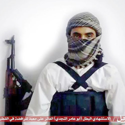"""A militant website associated with Islamic State extremists purports to show a suicide bomber,  with an Arabic bar below reading: """"Urgent: The heroic martyr Abu Amer al-Najdi, the attacker of the (Shiite) temple in Qatif,"""" which the Islamic State group's radio station claimed responsibility for.  The Associated Press"""
