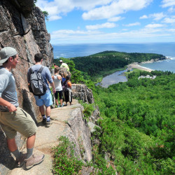 A line of hikers files up the Beehive Trail near Sand Beach at Acadia National Park in Bar Harbor.   Michael G. Seamans/Staff Photographer