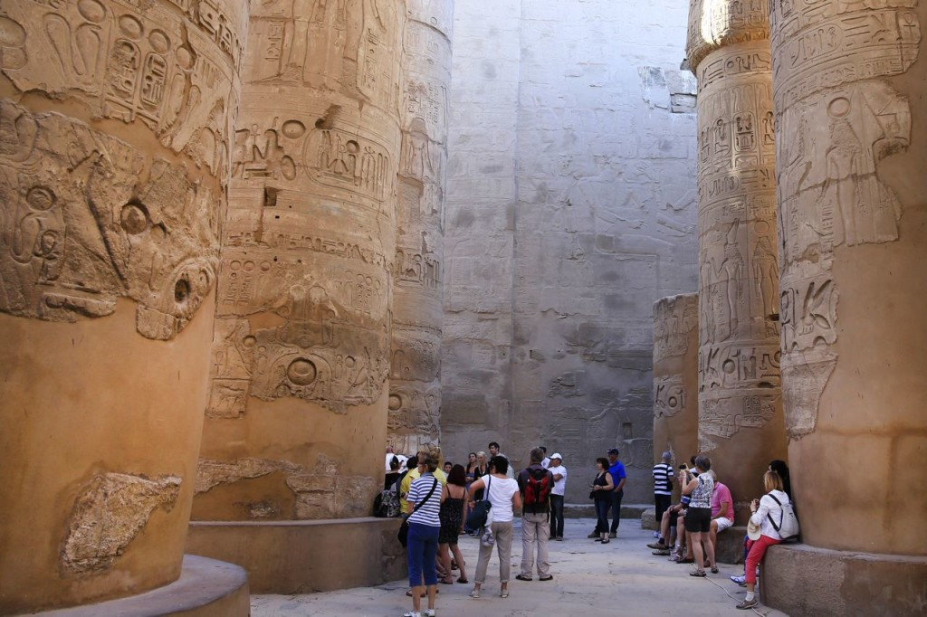 Tourists roam among the hieroglyphic-covered columns in the Hypostyle Hall at the Karnak Temple in Luxor, Egypt, in this 2014 photo. The southern city of Luxoris frequented by millions of foreign and Egyptian tourists every year. The Associated Press