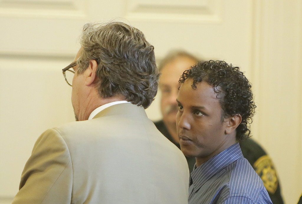 Mohamud Mohamed looks to his attorney, Thomas Hallett, during Mohamed's arraignment at York County Superior Court in Alfred on Friday. He pleaded not guilty to charges of murder and conspiracy in the death of Charles Raybine in 2013.