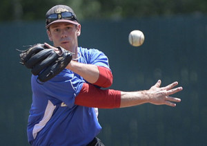 Old Orchard Beach infielder Chris Ray makes a throw during practice Thursday. The Surge split their first two games against the Watertown (N.Y.) Bucks and face the Bucks again in their home opener Tuesday night.