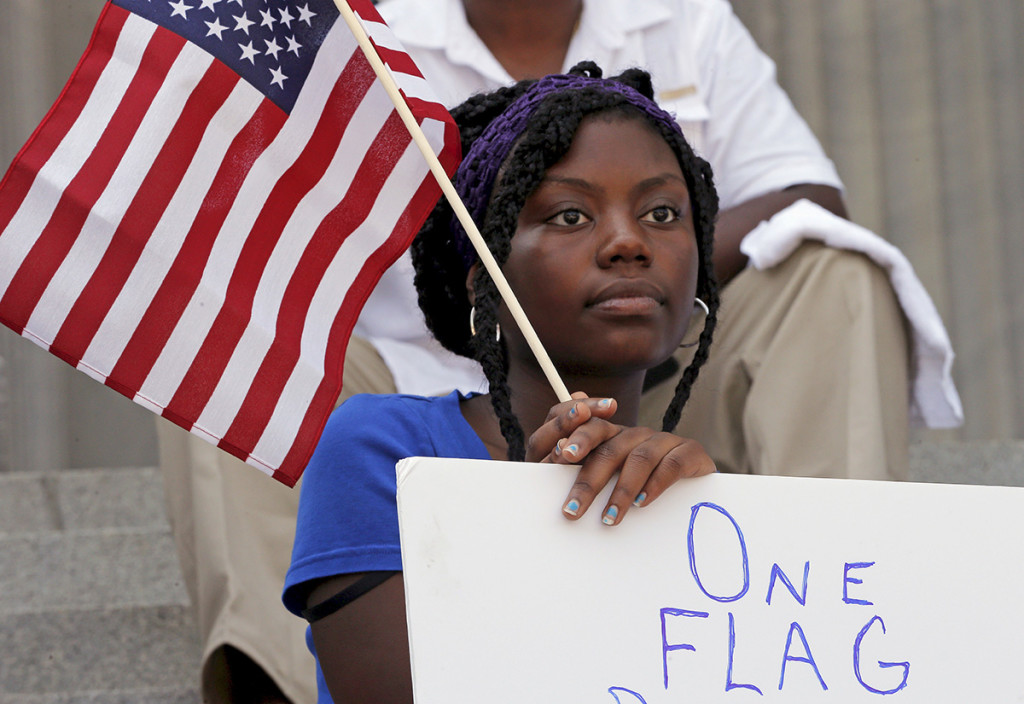 Asha Jones listens to the speakers during a rally outside the State House in Columbia, South Carolina, Tuesday. Reuters