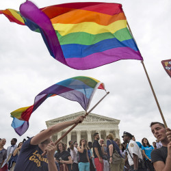 Supporters of gay marriage wave the rainbow flag in Washington on Friday after the U.S. Supreme Court ruled that the U.S. Constitution gives same-sex couples the right to marry.     Reuters
