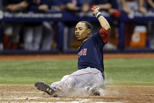 Red Sox center fielder Mookie Betts scores the winning run against the Tampa Bay Rays on Friday. The Associated Press