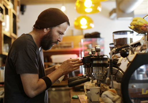 Employee J.P. Aristizabal prepares coffee drinks recently at Panther Coffee, an independently owned coffee retailer and wholesaler in Miami. Over the past year, restaurant and bar receipts for the nation as a whole have surged 8.2 percent. The Associated Press