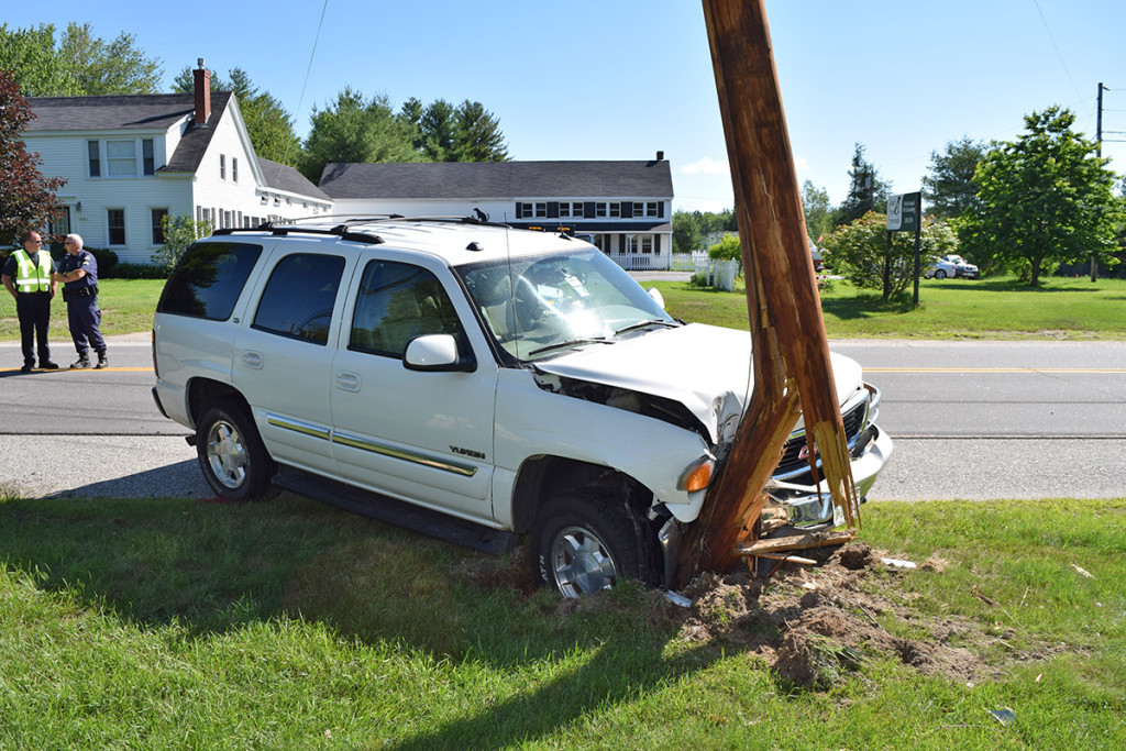 This GMC Yukon was forced off the road during the collision, but its driver escaped injury.. Gorham Police Department photo