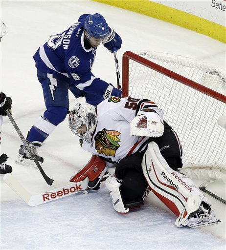 Tampa Bay Lightning center Tyler Johnson scores past Chicago Blackhawks goalie Corey Crawford during the second period in Game 2 of the NHL hockey Stanley Cup Final on Saturday in Tampa. This Stanley Cup series fin which neither team has enjoyed a two-goal lead through the first five games.The Associated Press