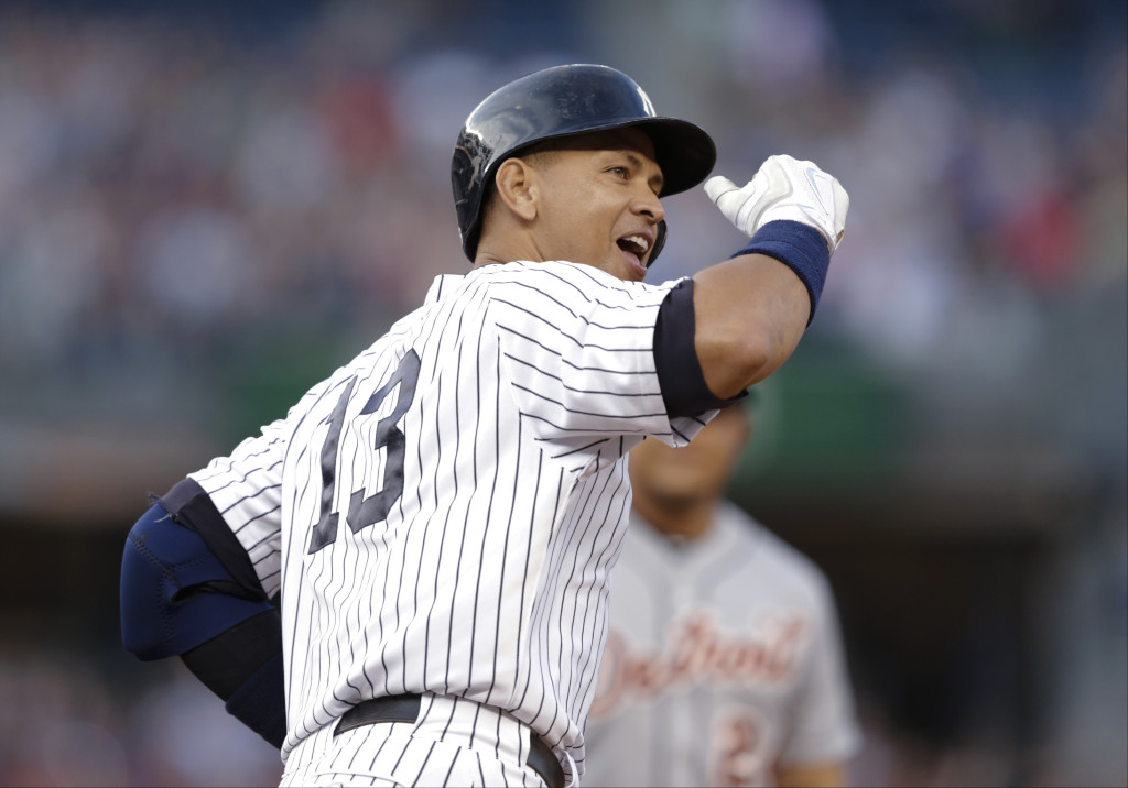 The New York Yankees' Alex Rodriguez gestures to the crowd after hitting a home run for his 3,000th career hit in the first inning of Friday night's game against the Detroit Tigers in New York. The Associated Press