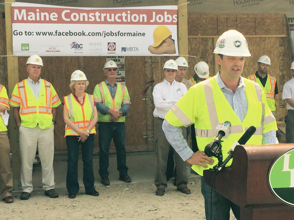 Timothy Ouellette, chief financial officer of Freeport-based CPM Constructors, speaks at a news conference in South Portland to advocate for letting voters decide bond questions on funding infrastructure and housing projects.