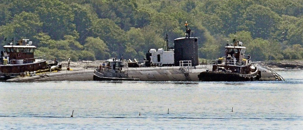Tugs assist as the former USS Miami nuclear-powered submarine is towed from the Portsmouth Nasal Shipyard in Kittery on June 12, 2015. U.S. Navy photo via AP