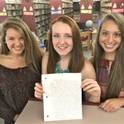 "High school students Mollykate Rodenbush, left, Brittany Tainsh and Michaela Arguin hold a letter from former Boston crime boss James ""Whitey"" Bulger in Lakeville, Mass. The three Apponequet Regional High School students wrote to Bulger for a history contest on leadership and got a surprising letter back. David L Ryan/The Boston Globe via AP"