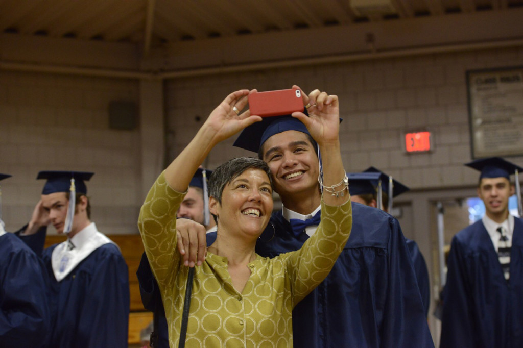 Portland High School English teacher Karen Phillips takes a selfie with Kevin Hong before the graduation ceremony at Merrill Auditorium on June 4.