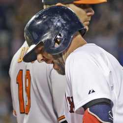 Dustin Pedroia grimaces after injuring his hamstring rounding first base on a single in the sixth inning against the Orioles at Fenway Park on Wednesday. The Asxociated Press