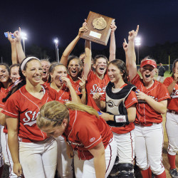 Scarborough girls hold high their regional championship trophy following their 7-3 win over Thornton Academy Wednesday. John Ewing/Staff Photographer