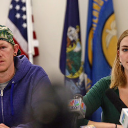 Justin Irish, a survivor of a fire on Noyes Street that killed six people, and Grace Damon, co-chair of the tenant's union, urge the city to police landlords to keep rental units safe. Whitney Hayward / Staff Photographer