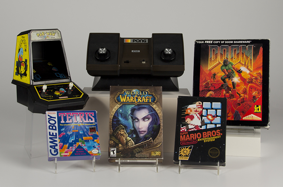 The six games inducted into the new Video Game Hall of Fame on June 4, 2015 include (clockwise from top left):  Pac-Man, Pong, Doom, Super Mario Bros., World of Warcraft and Tetris.