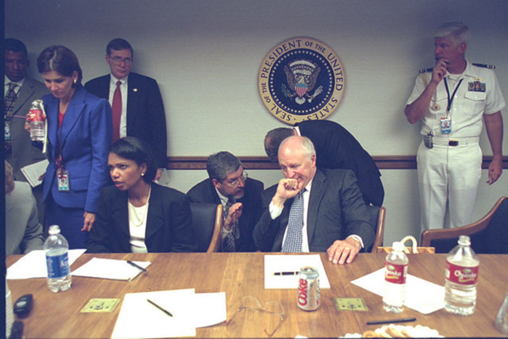 The vice president's top lawyer, David Addington (kneeling), conferred with Cheney. Addington would begin to secure the legal authority to respond to the attacks. Photo courtesy of PBS.org.