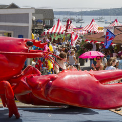 Carl D. Walsh/Staff Photographer: Large crowd funnels into Rockland's Annual Lobster Festival , past a giant cristacean, on Saurday August 6, 2011 in Rockland, Maine.