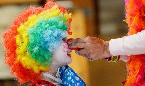 """Bellana Pachon 6, of Springfield, Virginia, who goes by the clown name """"Beany,"""" gets help putting on her clown nose during the """"So You Want to Be A Clown"""" workshop in Ocean Park. The workshop was put on by the Ocean Park Association as part of the Independence Day Festivities."""