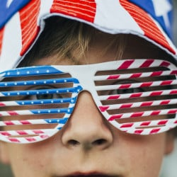 Riley Campbell wears flag glasses at the Fourth of July celebration on the Eastern Promenade. Whitney Hayward/Staff Photographer