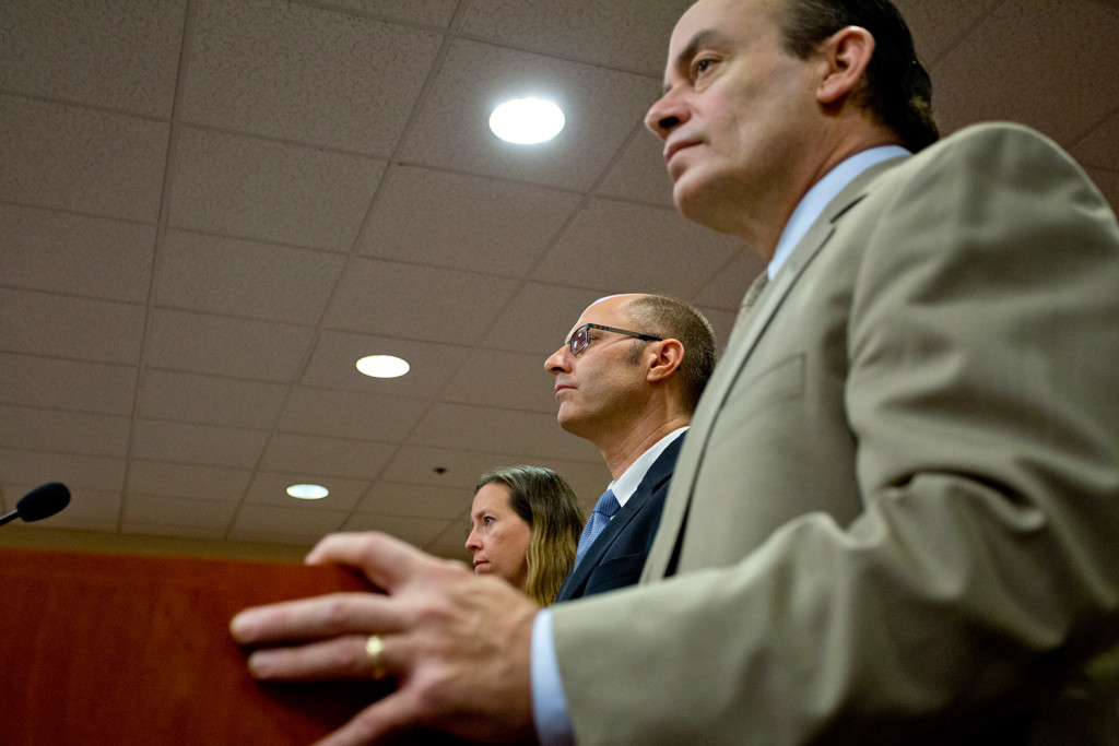 Gregory Nisbet, center, is flanked by his attorneys Sarah Churchill, left, and Matthew Nichols, right, as he is arraigned on six charges of manslaughter at the Cumberland County Courthouse on Friday.
