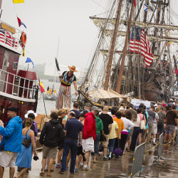 People wait to tour the tall ships at the Maine State Pier in Portland.  Carl D. Walsh/Staff Photographer