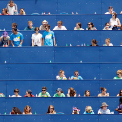 PORTLAND, ME - JULY 13: From the seats above the right field fence, Sea Dogs fans watch a midday home game against the Binghamton Mets on Monday, July 13, 2015. Attendance at home games for the Sea Dogs has been low this year. (Photo by Gregory Rec/Staff Photographer)
