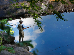 Paul Ersing, 14, of Wells casts his line below Ledgemere Dam on the Waterboro and Limerick town line while fishing with campers from the Kennebunk Recreation Department.