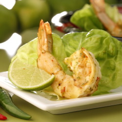 Shrimp are marinated in piri piri sauce, then quickly sauteed before being served in lettuce leaves with more of the spicy sauce.